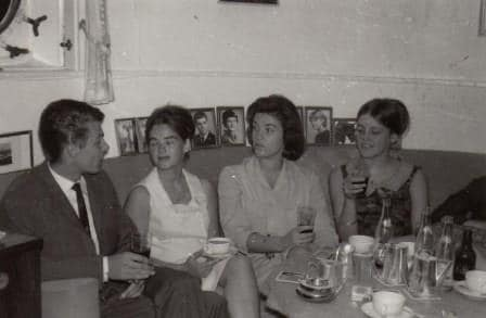 Some of his children in the captains cabin. Note the row of photos behind the settee.
