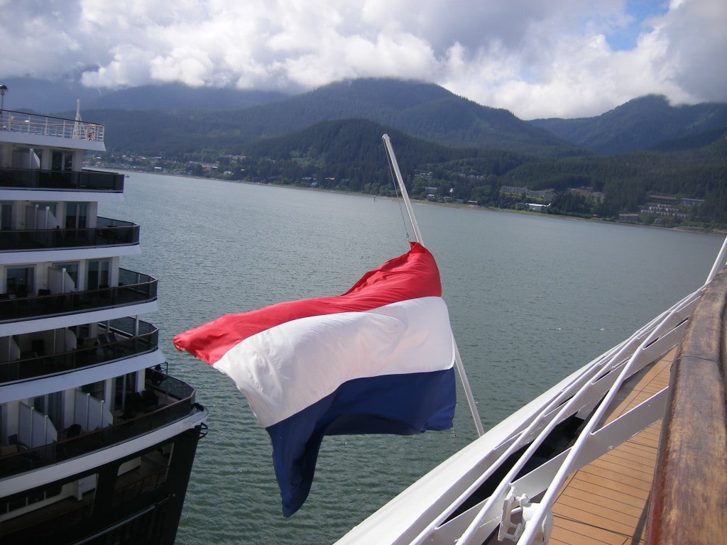 The flag of the ms Amsterdam at half mast