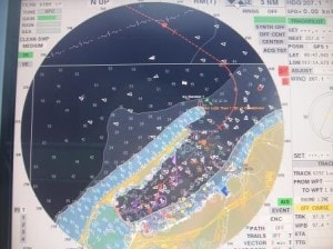 All the white dotson the radar screen  are AIS indicators from boats involved in the off-shore industry