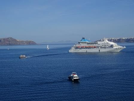 The Crystal on the only anchorage, a small under water bump rising up from a 1000 ft. In the foreground the shore tenders of Santorini.