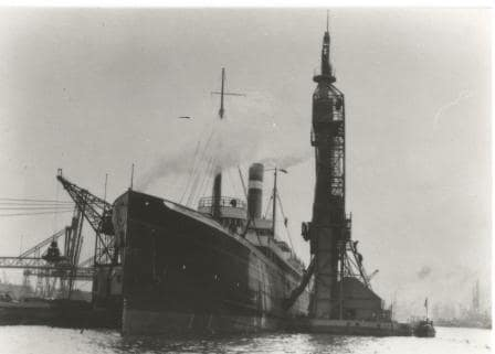 Frontal view of the Warsazwa while taking on coal in Rotterdam.