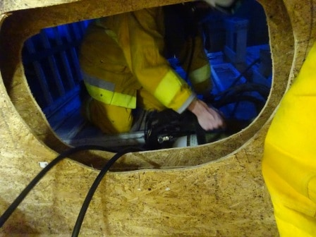 A tank opening is not easy to get into in full fire fighting gear.