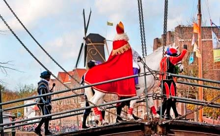 How more dutch can you go? Sinterklaas on a drawbridge with a windmill in the background. This was arrival in the town of Leiden.