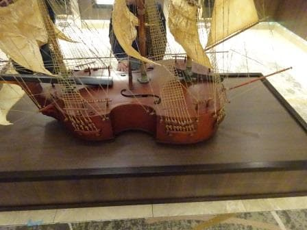 ....................Until you look at the side and you see it is a square rigged Violin.