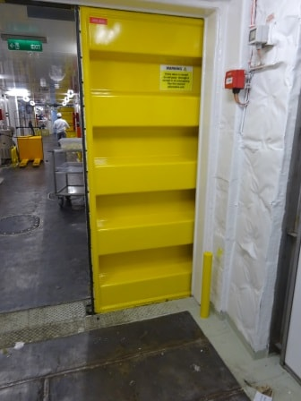 This is such a big/half open door in the Provision area. When in port the bridge will open the rest of the door and palletjacks and big boxes can go through. At sea the half door still allows for quick passage  by crew and quick closing if needed.