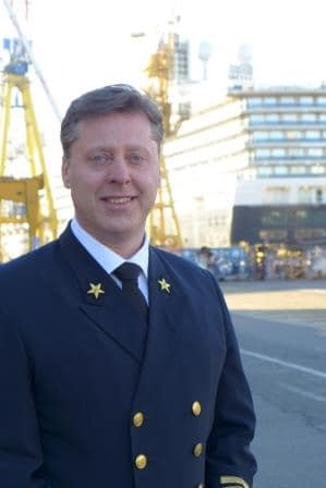 Capt. Emiel de Vries at the shipyard with the ms Koningsdam in the background. Shortly before the final departure.