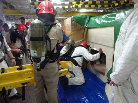 Tank entry by the rescue team taking a plank-type stretcher with them for the extraction.