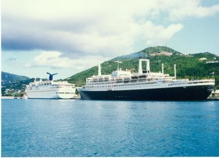 A nostalgic view of the late 1980's. The ss Rotterdam docked behind a Carnival Holiday class ship.